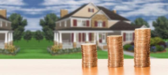 積まれたコインと家