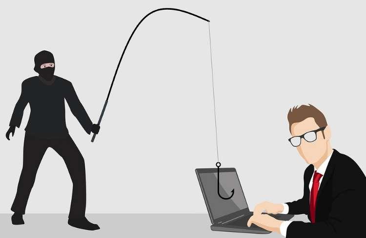 ビジネスマンのパソコンから釣り竿と釣り針で情報を盗みだそうとする泥棒