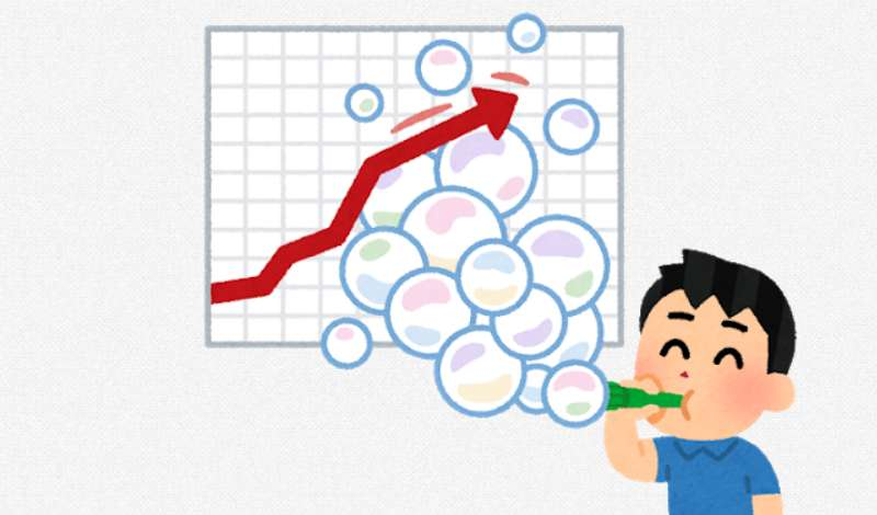 バブルを示すチャートの前でシャボン玉を吹く男の子